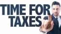 Business man pointing the text Time for Taxes